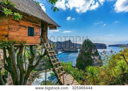 Tree House And Diamond Beach In Nusa Penida Island, Bali In Indonesia.