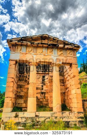 Treasury Of Athens At The Archaeological Site Of Delphi. Unesco World Heritage In Greece