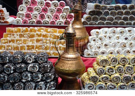 Turkish Delight. Turkish Desserts On Sale Sorted At The Counte. Stack Of Turkish Delicacies.
