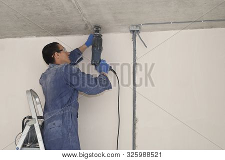 Electrician Attaches Wire