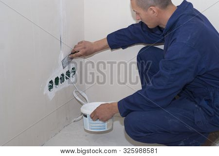 Electrician Installs Socket Boxes