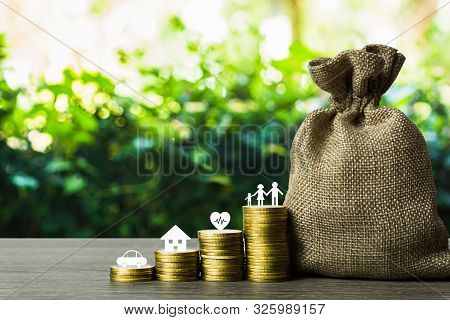 Savings Money For The Future Concepts. Family Member, Car, House, Healthy On Stack Of Coins With Mon