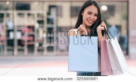 Happy Beautiful  Woman Enjoying In Shopping.