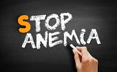 Stop Anemia text on blackboard, concept background poster