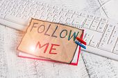 Text sign showing Follow Me. Conceptual photo Inviting a demonstrating or group to obey your prefered leadership notebook paper reminder clothespin pinned sheet white keyboard light wooden. poster