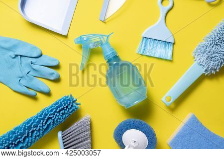 House Cleaning Blue Product On Wood Table With Yellow Background, Home Service Or Housekeeping Conce