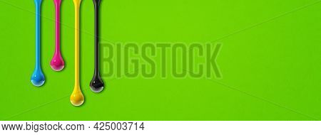 3d Cmyk Ink Drops Isolated On Green Paper Background. Horizontal Banner. Illustration