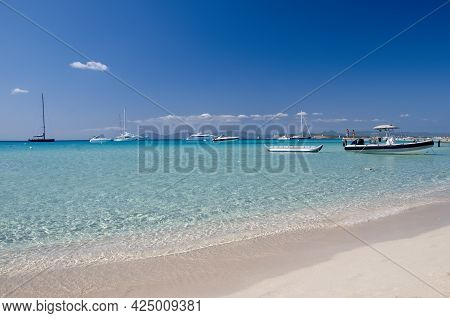 Ses Illetes Beach In The Island Of Formentera, Spain. In The Background Anchored Boats And The Blue