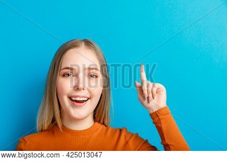 Happy Young Woman Showing Thumb Up By Hand At Copy Space. Teenage Girl Joyful Emotionally Smiling An