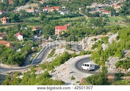 white minibus on the winding road from Razem to Shkoder, Albania
