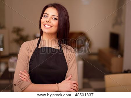 Beautiful young smiling housewife is proud of her appartment