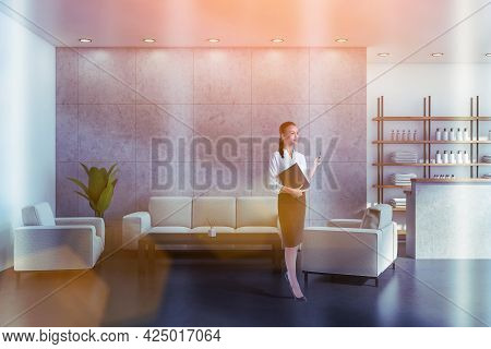 Attractive Woman Holding Black Folder With Membership Contract, Waiting For Clients In Reception Are