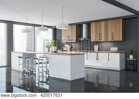 Corner Of White Wooden Kitchen With Panoramic View. White Lower Cabinets. Big Table With Wooden Work
