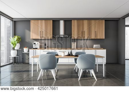Front View Of Panoramic Kitchen Area Of Studio With Grey Wall And Tiling Floor, Wooden Half White Ca