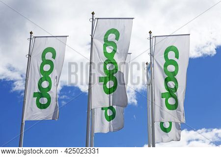 Umea, Norrland Sweden - June 7, 2021: Coop Flags Outside Grocery Store