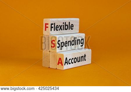Fsa Flexible Spending Account Symbol. Concept Words Fsa Flexible Spending Account On Wooden Blocks O