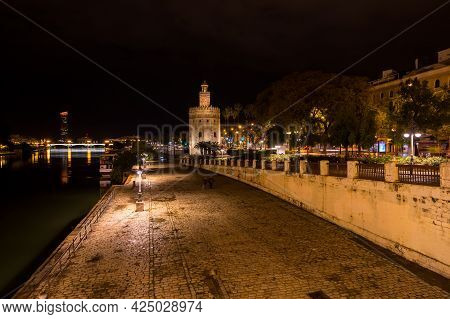Seville, Spain - 07 April, 2019: Torre Del Oro, Historical Limestone Tower Of Gold In Seville, A Big