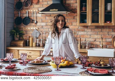 Woman Has Set The Table And Is Ready To Welcome Guests.