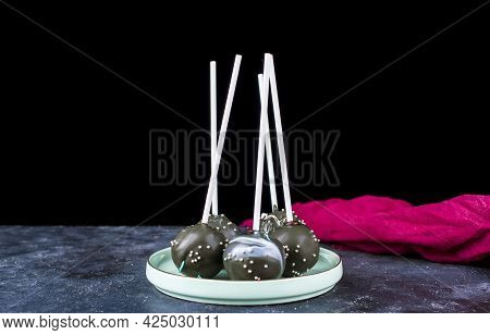 Delicious Chocolates On A Stick On A Dark Background. Cake Pops