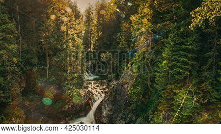 Tatra National Park, Poland. Waterfall Wodogrzmoty Mickiewicza In Summer Mountains Sunset Landscape.