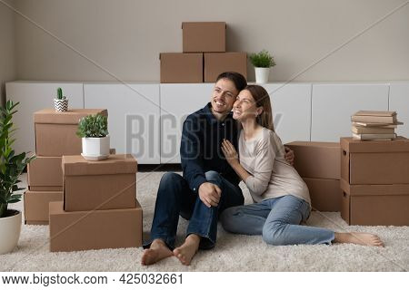 Happy Couple Renters Celebrate Relocation To New Home Hugging