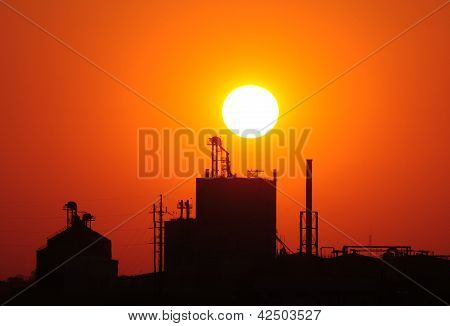 Silhouette of grain elevator at sunset