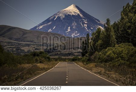 Road In Patagonia Argentina. In The Background The Famous Volcán Lan´ín (lanín Vulcano) That Gives N