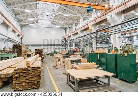 Factory Workshop Inside Interior, Stack Of Wooden Boards In Woodworking Factory.