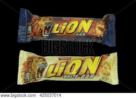 Poland, Warsaw - June 24, 2022: Lion Chocolate Bar On A Black Background. Lion Bar And Delicious Whi