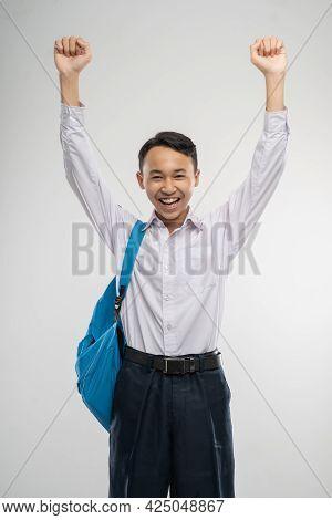 A Boy Raised Hands In Junior High School Uniform Smiling With School Bag