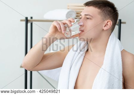 Thirsty Man. Body Hydration. Healthy Lifestyle. Attractive Shirtless Guy With White Towel On Shoulde