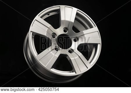 New Silver Alloy Wheels For Suvs On Black Background, Side View