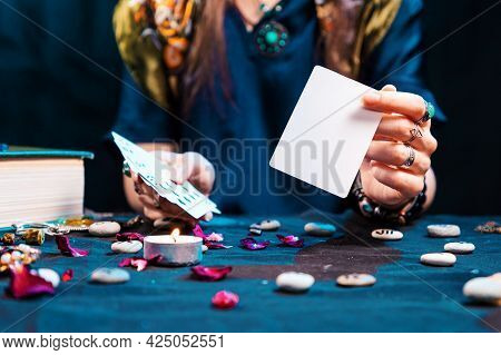 The Fortune Teller Shows An Empty White Tarot Card. Mock Up. Copy Space. Cartomancy And Fortune Tell