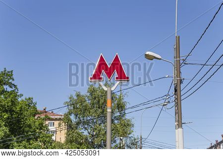 Moscow Metro. A Sign Above The Entrance To The Metro Station. Red Letter M With Electric Backlight A