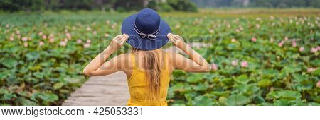 Banner, Long Format Young Woman In A Yellow Dress On The Path Among The Lotus Lake. Mua Cave, Ninh B