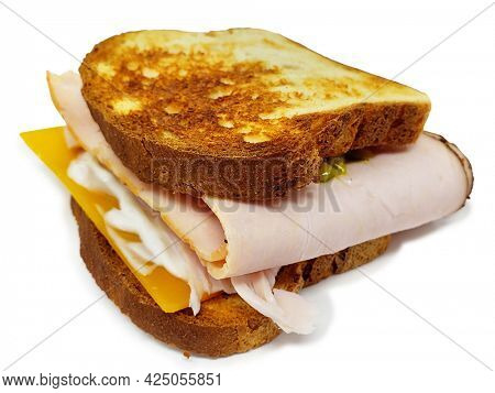 Toasted Turkey and Cheese Sandwhich on Gluten Free Bread with clipping path over white background.