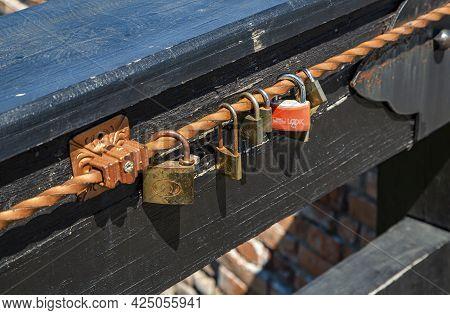 Alba Iulia, Alba, Romania -  May 11, 2021: Love Symbol, Old Rusty Padlocks Hanging On Wooden Fortres