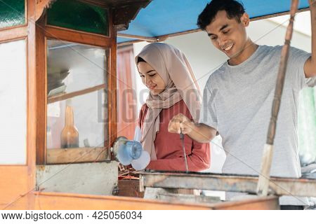 Two Seller Preparing Food On Their Food Stall Selling Traditional Chicken Satay