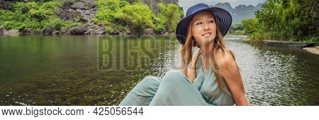 Banner, Long Format Woman Tourist In Trang An Scenic Landscape Complex In Ninh Binh Province, Vietna