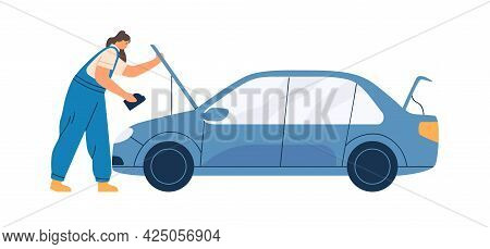 Female Mechanic In Overalls Repairing Car. Woman Working In Auto Service, Standing With Oil Canister
