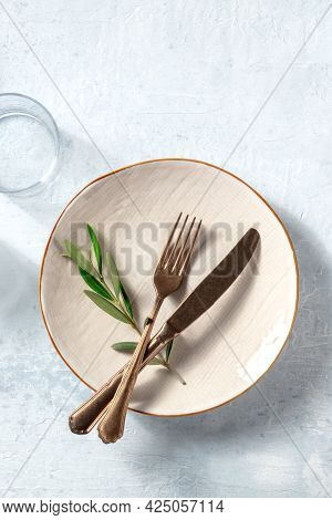 A Plate With Cutlery And A Glass, With An Olive Branch, Shot From The Top. Mediterranean Cuisine Res