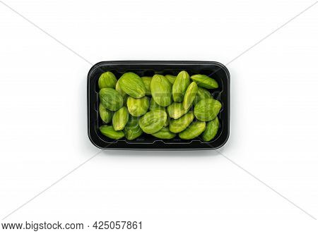 Top View Fresh Bitter Beans In A Plastic Black Tray For Sale On White Background, Bitter Beans Or Sa