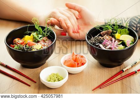 Loving Couple Man And Woman Eating Salad Poke Chopsticks. Place The Tuna Salad In A Bowl. People In