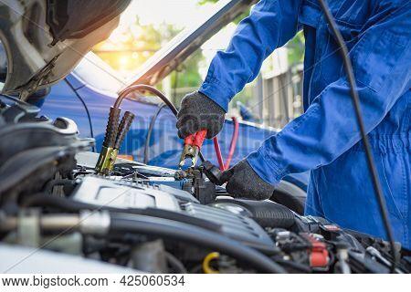 Maintenance Car Using Screwdriver. Mechanic Man Hands Holding Tools Fixing Repair Car Engine. Mechan