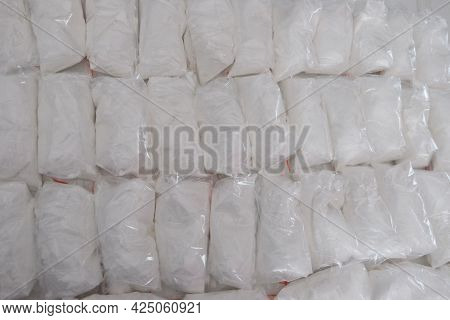 A Large Number Of Transparent Sachets Filled With White Powder. White Powder Packaged In Small Sache