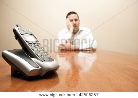 Bored Man Waits For The Phone