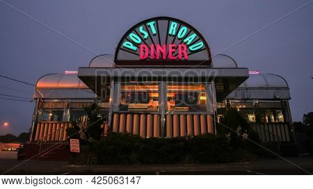 NORWALK, CT, USA - JUNE 25, 2021:  Post Road Diner sigh with lights on early morning