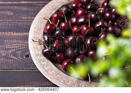 Pile Of Ripe Sweet Cherries With Stalks In A Tray