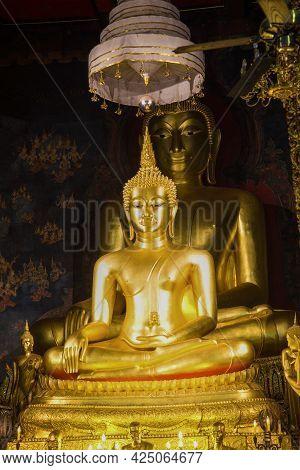 Bangkok, Thailand - January 06, 2017: Two Seated Buddha Sculptures On The Altar Of Wat Bowonniwet Bu