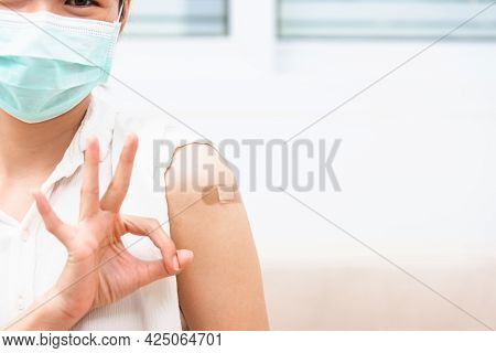 Asian Young Woman Smile She's Have Adhesive Plaster On Arm Her Vaccinated And Showing Ok Finger Sign